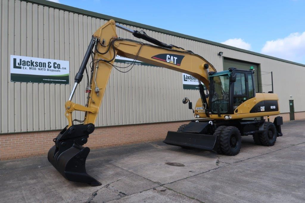 Caterpillar 318D Wheeled Excavator | Military Land Rovers 90, 110,130, Range Rovers, Mercedes for Sale