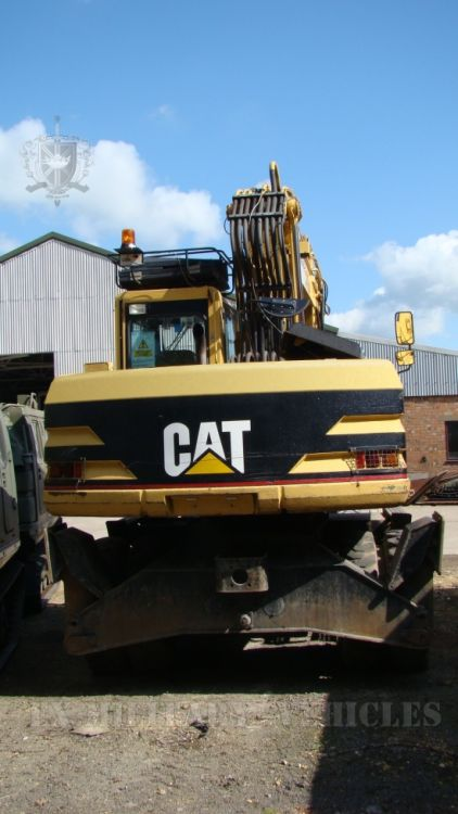 Caterpillar 318M wheeled excavator for sale
