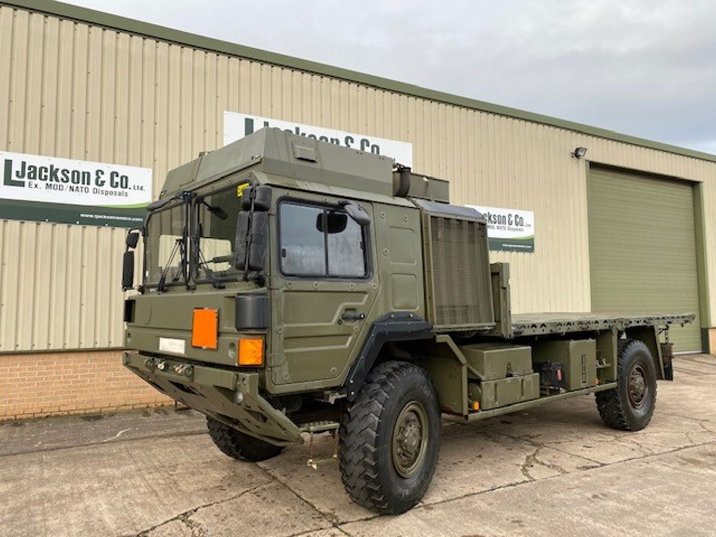 MAN HX60 18.330 4x4 Flat Bed Cargo Truck for sale | military vehicles
